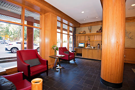 computer in lobby, red leather chairs infront of large windows